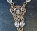 Filigree Crown Drop Necklace with Skull and Cross by KBD Studio
